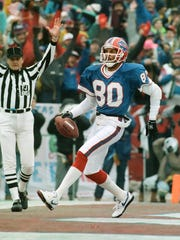 Bill receiver James Lofton celebrates a touchdown in a 51-3 win over the Raiders in the 1991 AFC Championship game.