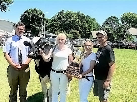 Pictured (from left) are Judge  Bryan Coyne, Dairy