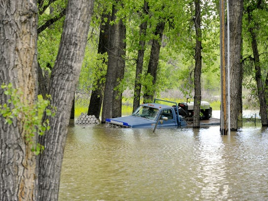 The Missouri River floods a yard in Woodland Estates,