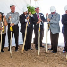 Ned Norris, Jr., Chairman of the Tohono O'odham Nation, fourth from left, is joined by others as they dig the earth with planting sticks at the groundbreaking for the new West Valley Resort and Casino that will be built near the Loop 101 and Northern in Glendale. From left to right are; Tohono O'odham councilman Billman Lopez, councilwoman Ethel Garcia, Glendale City councilman Ian Hugh, Norris Jr., Glendale City councilman Gary Sherwood, Peoria Mayor Bob Barrett, Chairman of the Tohono O'odham Legislative Council Timothy Joaquin, and Tohono O'odham councilwoman Frances Miguel.