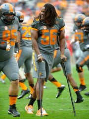 Injured Tennessee linebacker Curt Maggitt (56) watches as his teammates warm up before Tennessee plays Georgia  on  Oct. 10, 2015.
