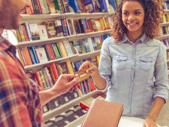 Customers shopping in a bookstore.