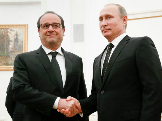 FILE- In this Thursday, Nov. 26, 2015 file photo, Russian President Vladimir Putin, right, shakes hands with his French counterpart Francois Hollande during their meeting in Moscow, Russia. Amid a bitter rift over Syria, Russian President Vladimir Putin indefinitely postponed a visit to France after Paris had revised its program and said it would talk about nothing else but the Syrian crisis. (AP Photo/Alexander Zemlianichenko, Pool, File)