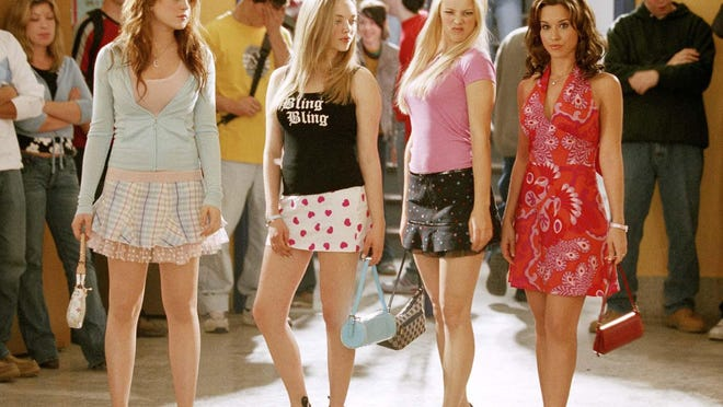 "From left, Lindsay Lohan as Cady, Amanda Seyfried as Karen, Rachel McAdams as Regina and Lacey Chabert as Gretchen in ""Mean Girls,"" which screens Aug. 14 at UNCW for the drive-in Curbside Cinema series."