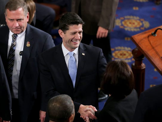 Paul Ryan greets fellow lawmakers on the House floor