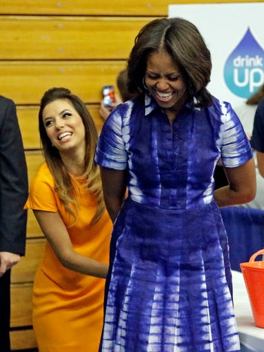 First lady Michelle Obama has strategically enlisted celebrities to help sell her causes. The most recent: actress Eva Longoria, who joined her in Watertown, Wis., on Sept. 12 for her healthy living campaign, urging people to drink more water. It's a tried-and-true messaging strategy that works, although sometimes the attention wanders away from the cause to whatever the stylish first lady is wearing. Notice here her eye-popping tie-dye shirt dress by Tory Burch (sorry, all sold out) in bright blue, while Longoria glows in a simple sherbet-orange frock.