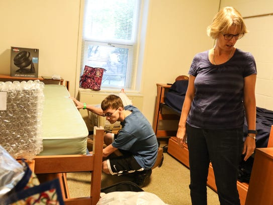 Travis King checks out his dorm with his mother Wendy