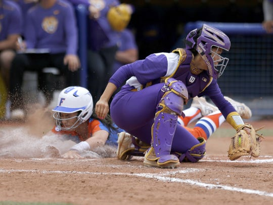 Florida's Alex Voss slides into home as LSU?s Savanna