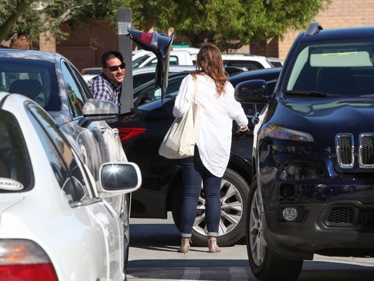 A driver picks up a woman who was carrying luggage