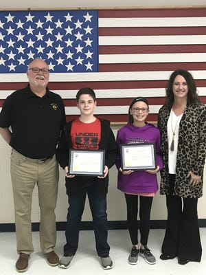 Local winners of the 2017~2018 Arkansas State Elks Americanism Essay Contest were recently honored during an awards assembly at Pinkston Middle School. Sixth-grade winners were: Gray Padgett, who took first in the state certificate and won$200;and Merritt McConnell, was was third in the state and won $100. Their essays were chosen from over 280 essays locally and then competed on a statewide level. Padgett's essay will now go on to compete for national honors. This is the fourth consecutive year that Pinkston Middle School students have won the state contest. Pictured are: (from left)Wayne Markham, Elks president; Padgett; McConnell; and Vonya Schaufler, sixth-grade teacher and Mountain Home Elks Americanism chairman.