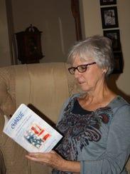 Joanna James Sieberg looks over the book she wrote