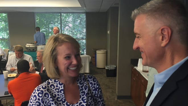 Catherine Templeton, a possible Republican candidate for governor, speaks with GOP nominee for state representative Jason Elliott of Greenville at the Greenville Chamber Wednesday.