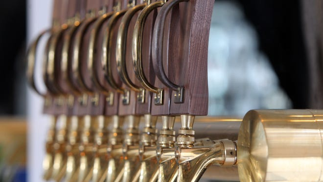 Beer taps at Coppin's in the Hotel Covington.  The Enquirer/Patrick Reddy