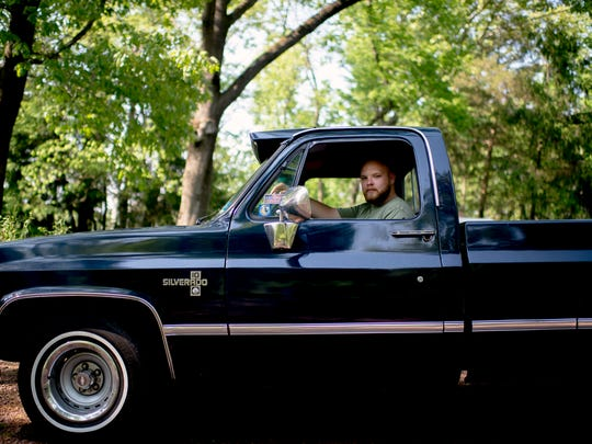Zack Staszak-Saler, 19, sits at the wheel of his 1983 Chevy C-10 outside his home in Washington Township. The president of the South Jersey Square Truck Body Club is organizing a charity fundraiser to benefit the City of Angels' recovery coach program. A loved one relapsed into active addiction five years ago, and he wanted a way to help others affected by substance use disorder.