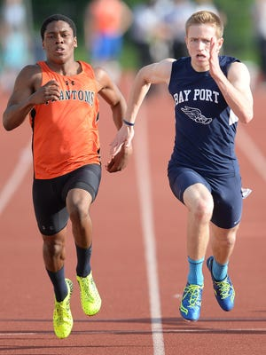 Ryan Powers of Bay Port, right, sprints to the finish of the 100 meter dash shoulder to shoulder with West De Pere's Dom Conway during the WIAA sectional meet at Schneider Stadium in De Pere.