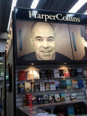 A booth for publisher HarperCollins features the image of Matthew Quick.