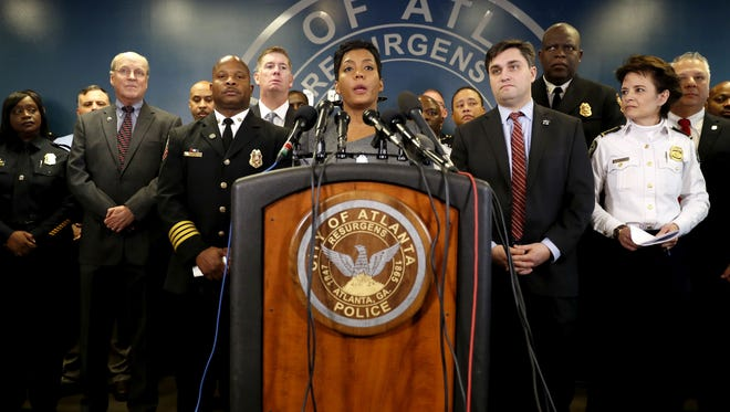 """Atlanta's Mayor Keisha Lance Bottoms speaks at a press conference in Atlanta, Thursday, Jan. 4, 2018. Atlanta's mayor is promising a """"safe, smooth and secure"""" college football championship game Monday, despite the traffic problems expected to be caused by President Donald Trump's motorcade, but none of the many agencies involved are taking any chances."""