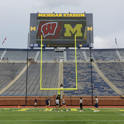 The stands are empty, but the field is ready before the Wisconsin Badgers game against the Michigan Wolverines at Michigan Stadium in Ann Arbor on Saturday.