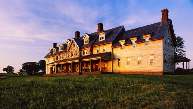 The Erin Hills clubhouse at sunset shortly after its completion in 2007. The course hosted the 2011 U. S. Amateur Championship and will host the 2017 U. S. Open Championship.