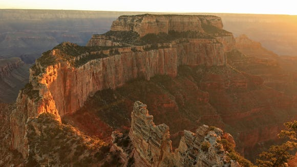 The sun sets over Cape Royal at the North Rim in Grand Canyon National Park.