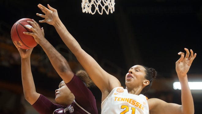 Texas A&M's Khaalia Hillsman gets the rebound over Tennessee's Mercedes Russell at Thompson-Boling Arena on Sunday, February 12, 2017.