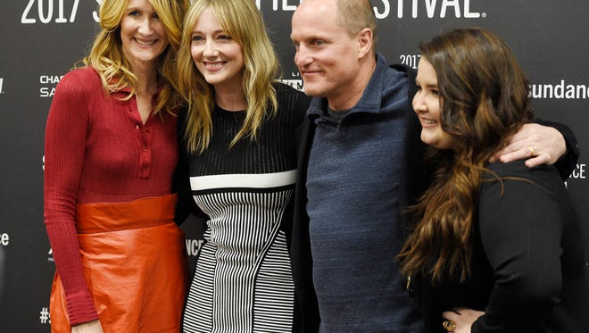 "Left to right, Laura Dern, Judy Greer, Woody Harrelson and Isabella Amara, cast members in ""Wilson,"" pose together at the premiere of the film at the Eccles Theatre during the 2017 Sundance Film Festival on Sunday, Jan. 22, 2017, in Park City, Utah. (Photo by Chris Pizzello/Invision/AP)"