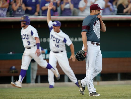 Jordan Knutson reacts after giving up a home run to