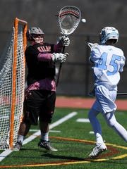 Boys lacrosse game between Lakeland and Mahwah at Mahwah High School on Saturday, April 8, 2017. L goalie #1 Anthony Scafuro looks to block a shot.