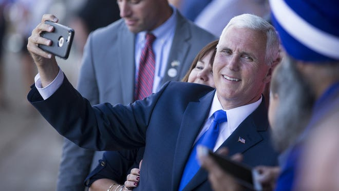 Mike Pence poses for photos and signs autographs for about 150 well-wishers at a homecoming rally at the Indianapolis Executive Airport for Pence, who is the running mate of presumptive GOP Presidential nominee Donald Trump, Zionsville, Saturday, July 16, 2016.