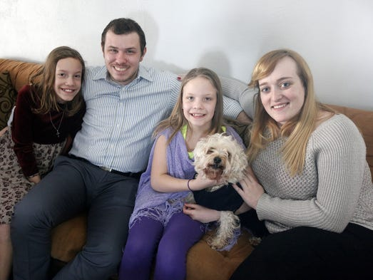 Ryan Craig, 25, of Newtown, with his wife, Megan, 24, and his twin sisters, Isabelle, 10, and Elizabeth, 10, along with their family dog, Reese. A little over two years ago, Ryan and his sister's mother passed away, leaving Ryan to make the choice to file for legal guardianship since the girls' father was no longer in the picture. Ryan and Megan have embraced the role of legal guardians of the girls.