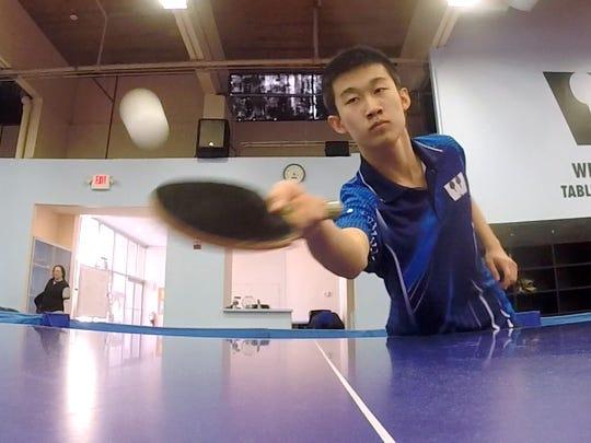 Pleasantville High School junior Kai Zhang is seen