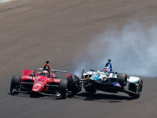 Takuma Sato  crashes into James Davison on the 47th lap Sunday.