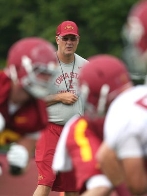 Iowa State head football coach Paul Rhoads looks on as his players run a drill during an open practice on Friday, Aug. 7, 2015, at the Iowa State practice facility near Jack Trice Stadium in Ames, Iowa.