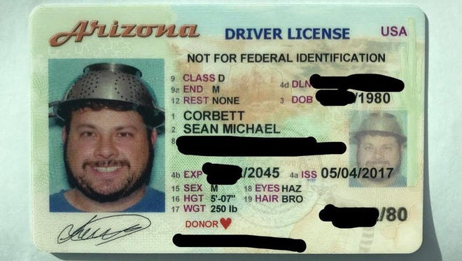 Sean Corbett of Chandler took his official driver's license photo wearing a spaghetti strainer on his head.