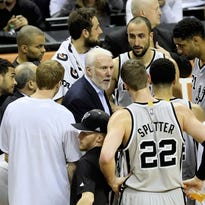 The Spurs huddle during a game against the Dallas Mavericks on March 27, 2015.