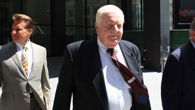 Former Chicago police commander Jon Burge walks with members of his legal team into the Dirksen U.S. Courthouse, on June 28, 2010, in Chicago. Burge was convicted on all counts of an indictment charging him with perjury and obstruction of justice.