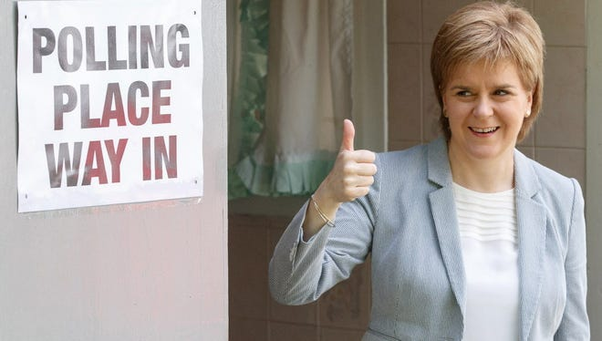 Scotland's First Minister and leader of the Scottish National Party, Nicola Sturgeon, poses for photographers as she leaves after voting at a polling station at Broomhouse Community Hall in east Glasgow, on June 23, 2016