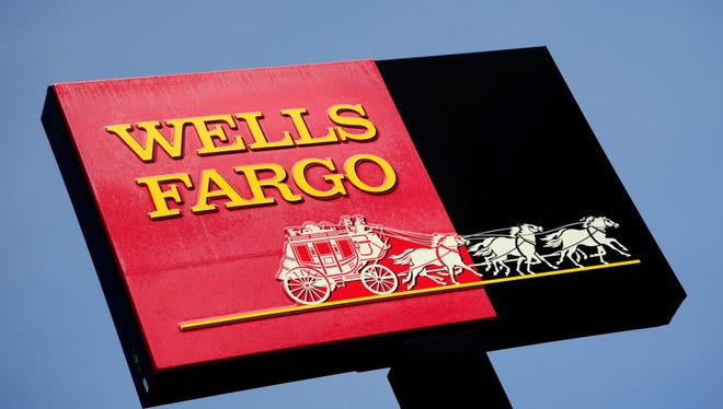 This file photo taken on May 22, 2009 shows the sign for a Wells Fargo bank in Woodbury, Minnesota.