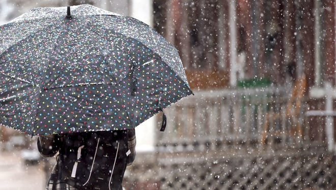 Snow falls in York County on Friday, just days before another storm is expected to hit the region.
