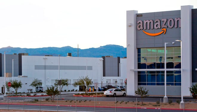 In this Dec. 5, 2017, file photo, an Amazon fulfillment center is shown in a commercial development near Interstate-15 and Tropical Parkway in North Las Vegas. Amazon is planning to build another warehouse distribution center in the Las Vegas area. The Seattle-based company and North Las Vegas announced Wednesday, April 4, 2018, the building should open next year on an 800,000-square-foot (74,322-square-meter) parcel of land east of Interstate 15, not far from the Las Vegas Motor Speedway.