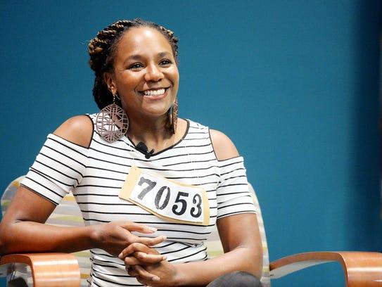 Bree Newsome, an activist and public speaker, listens