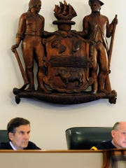 Delaware Supreme Court Justice Randy Holland (left) and Chief Justice Leo Strine listen to arguments in the appeal of James Cooke's death sentence for the slaying of Lindsey Bonistall in 2014. Holland announced Thursday that he will retire at the end of March.