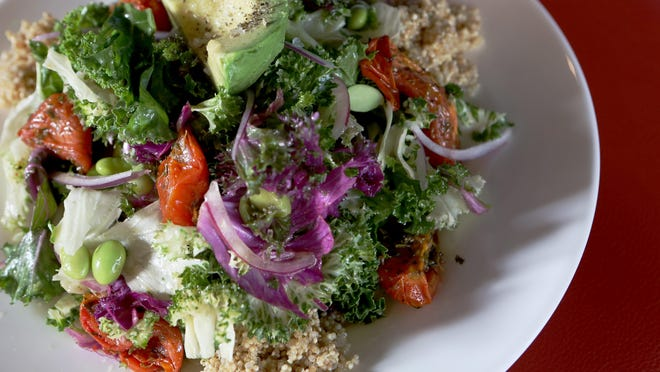 Kale, quinoa and edamame salad with red onions, avocado and lemon-thyme vinaigrette by Lachey's Bar in Over-the-Rhine. Kale is a great source of vitamin A, which supports eye health, kale also contains calcium, iron, and magnesium.