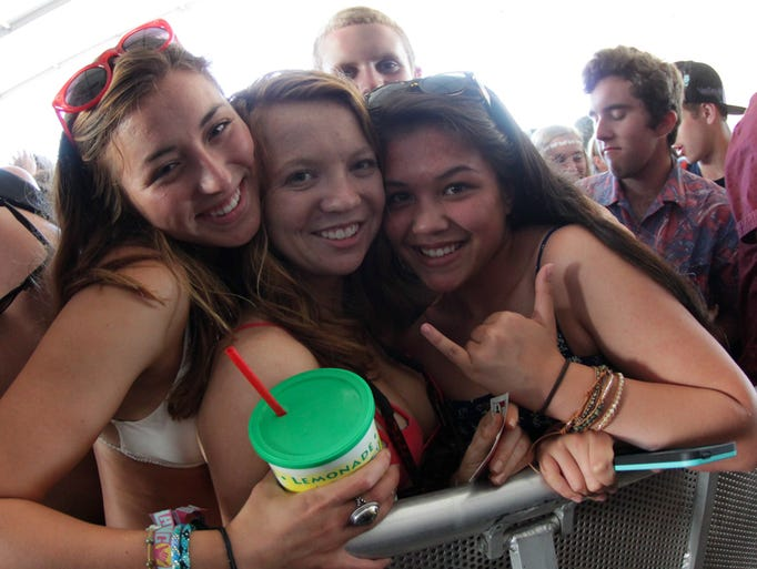 Fans watch The Bloody Beetroots perform in the Boom Boom Tent at the 2014 Hangout Music Fest early Saturday evening.