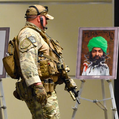 Heavily armed police at the Muhammad Art Exhibit and