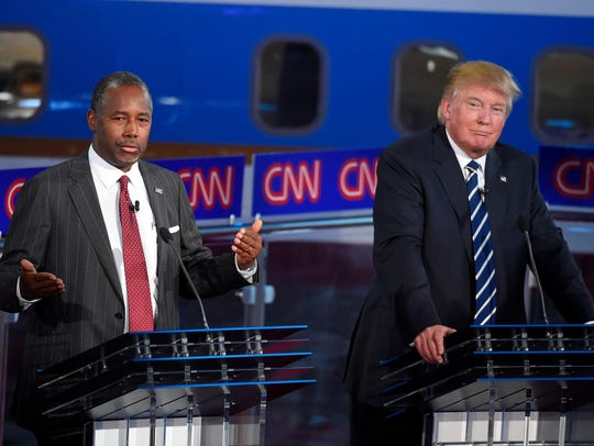 Ben Carson and Donald Trump take part in the Reagan