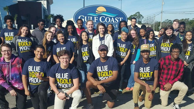 Navigator Scott Wilkes, ( back row right)  tours the Gulf Coast State College campus with students from Rutherford High School.