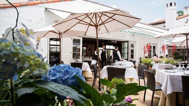 The dining terrace at Renato's in historic Via Mizner.