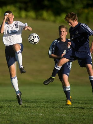 MMU's Thomas Pierce, left, deflects a header from Essex's Aidan Whitney, right, during their soccer match in Jericho earlier this month.
