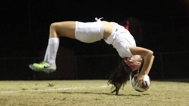 Leon's Madison Rumenik performs a flip throw during Thursday's District 2-4A final against Lincoln. Rumenik assisted on the game-winning goal in the 18th minute of the Lions' 3-0 win.